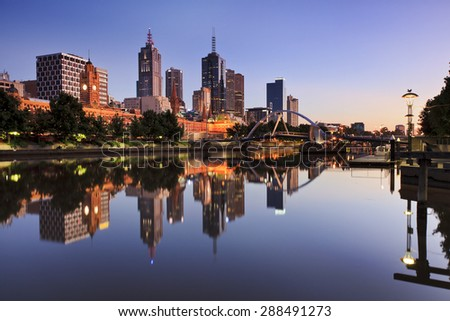 Melbourne capital city CBD reflection at waterfront of Yarra river at sunrise time still scene - stock photo