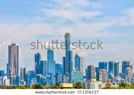 Melbourne city CBD cityscape rising over Yarra river on sunny summer day - stock photo