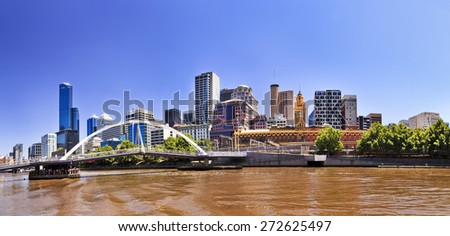 Melbourne city CBD modern cityline at Yarra river banks at midday - stock photo