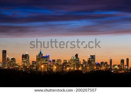 Melbourne City Skyline at sunset shot from Yarra Bend - stock photo
