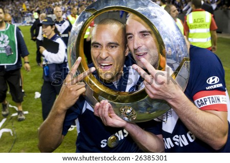 MELBOURNE - FEB 28: A-league Major Grand Final - Melbourne Victory defeat Adelaide United 1-0 on February 28, 2009 in Melbourne, Australia. Archie Thompson and Kevin Muscat celebrate their trophy. - stock photo