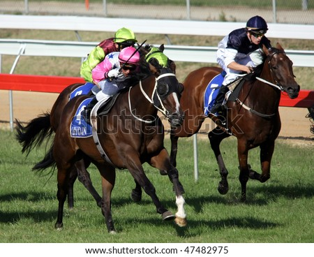 MELBOURNE - FEBRUARY 21: Madam Melba races past the field to win the Windy Peak Maiden at Yarra Glen on February 21, 2010 near Melbourne, Australia. - stock photo