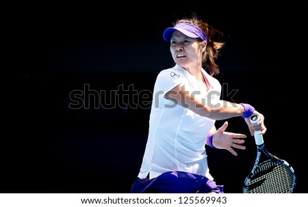 MELBOURNE - JANUARY 22: Li Na of China in her quarter final win over Agnieszka Radwanska of Poland at the 2013 Australian Open on January 22, 2013 in Melbourne, Australia. - stock photo