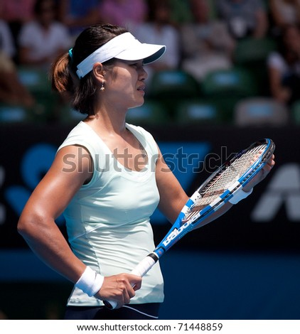 MELBOURNE - JANUARY 25: Li Na of China in her quarter final win over  third round win over Andrea Petkovik of Germany in the 2011 Australian Open on January 25, 2011 in Melbourne, Australia. - stock photo