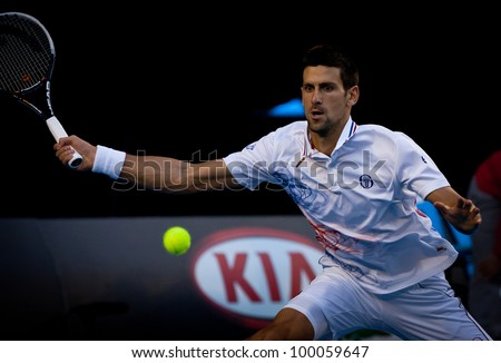 MELBOURNE - JANUARY 27: Novak Djokovic of Serbia in his semi final win over Andy Murray of Great Britain at the 2012 Australian Open on January 27, 2012 in Melbourne, Australia. - stock photo