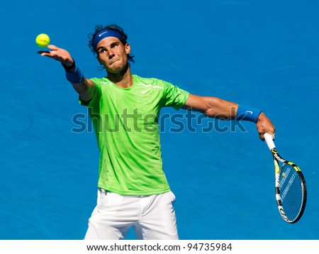 MELBOURNE - JANUARY 18:Rafael Nadal of SPain in his second round win over Tommy Haas of Germany at the 2012 Australian Open on January 18, 2012 in Melbourne, Australia. - stock photo