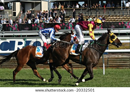 MELBOURNE NOVEMBER 6 - Nediym's Image (Chris Simons) and Mock (Dean Yendall) approach the finish line in the Sunrise Cup on 2008 Oaks day at Flemington in Melbourne - stock photo