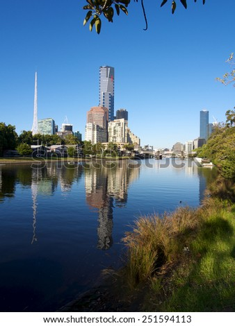 melbourne reflected in the yarra river on a bright summer morning - stock photo