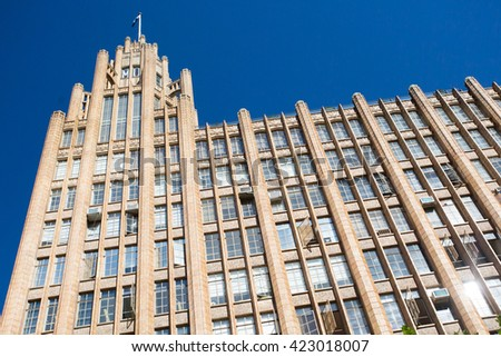 Melbourne's famous Manchester Unity building at the corner of Collins St and Swanston St. - stock photo