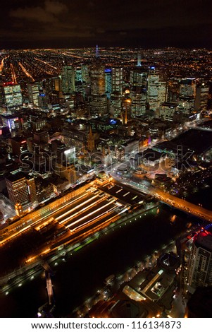 Melbourne's Flinders Street Station and Central Business District, aerial - stock photo