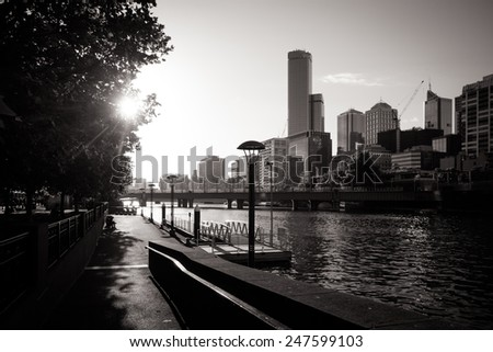 Melbourne's skyline along the Yarra River at sunset - stock photo