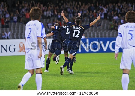 Melbourne Victory FC vs Gamba Osaka - Telstra Dome, 9th April '08 (#12 VARGAS, Rodrigo #9 ALLSOPP, Daniel #2 MUSCAT, Kevin) - stock photo