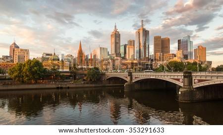 Melburne City, Yarra River, Princes Bridge with Reflection Cityscape Skyline background under dramatic Golden Sky Sunset, Australia - stock photo