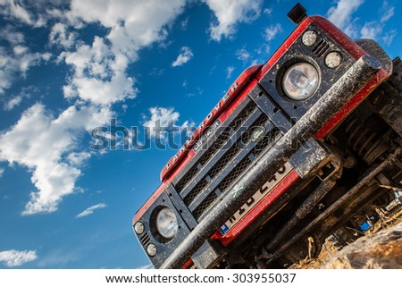 MELLIEHA, MALTA - OCTOBER 5, 2014: The iconic and legendary Land Rover Defender was issued in 1983 and sadly goes out of production in December 2015. - stock photo