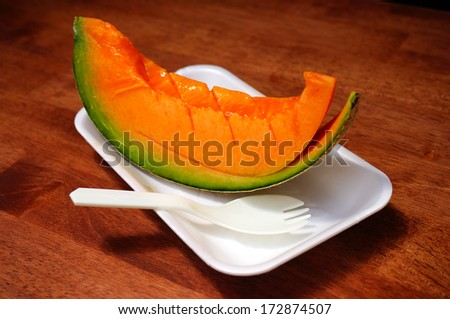 Melon on dish - stock photo
