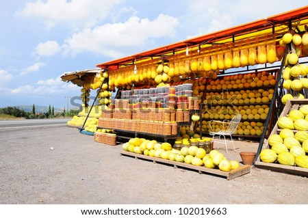 melons and olives are being sold by road - stock photo