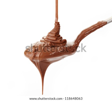 Melted chocolate flowing on a spoon - stock photo