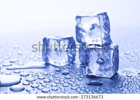 melting ice cubes - stock photo