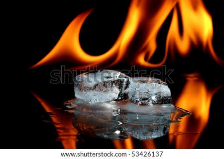 Melting ice cubes and fire - stock photo