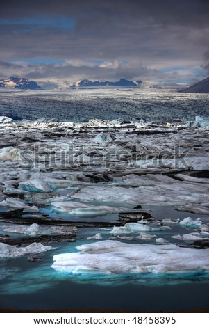 Melting Icebergs - Jokulsarlon glacier lagoon in Iceland - stock photo