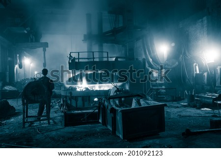 melting waste iron use electric old method in a steel making factory  - stock photo