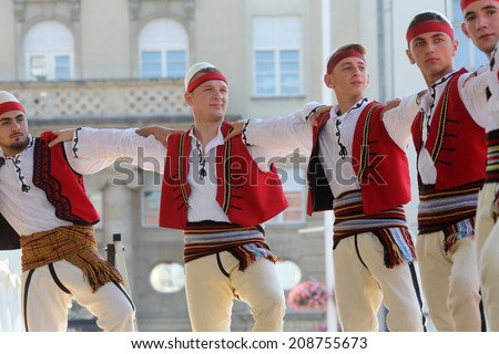 Members of folk group Albanian Culture Society Jahi Hasani from Cegrane, Macedonia during the 48th International Folklore Festival in center of Zagreb,Croatia on July 20,2014 - stock photo
