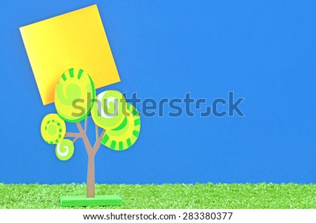 memo holder from wooden tree with yellow memo paper - stock photo