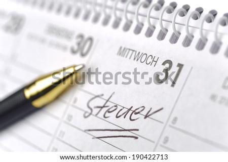 memo in calendar for german tax-day - stock photo