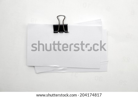 Memo note papers attached with paperclip - stock photo