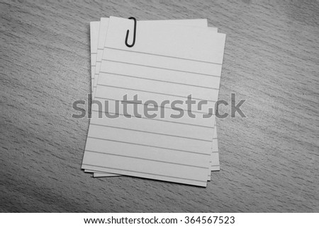 Memo notes with paper clip, black and white - stock photo