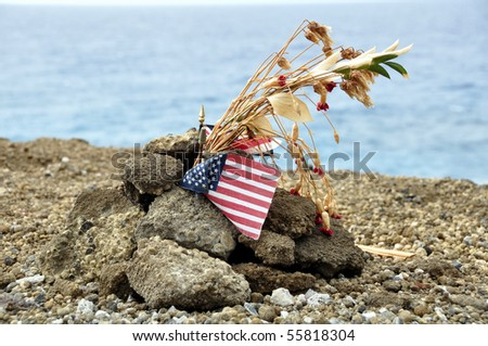 Memorial day tribute overlooking Pearl Harbour - with US and Hawaiian flags visible. - stock photo