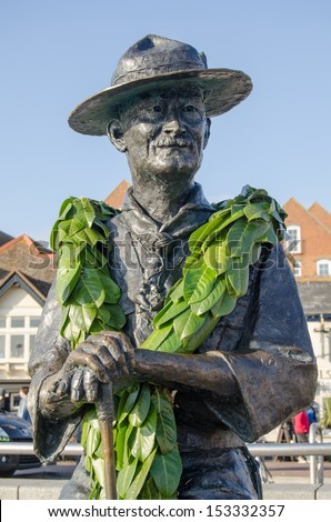 Memorial statue of Lord Baden Powell, founder of the Boy Scouts.  On public display overlooking the quay at Poole, Dorset. - stock photo