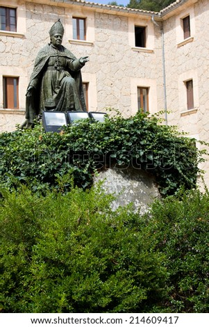 Memorial to bishop Pere-Joan Campins in cloistered courtyard of Santuario de lluc Monastery, county of Escorca in basin of the Serra Tramuntana Mountains on Mallorca - stock photo