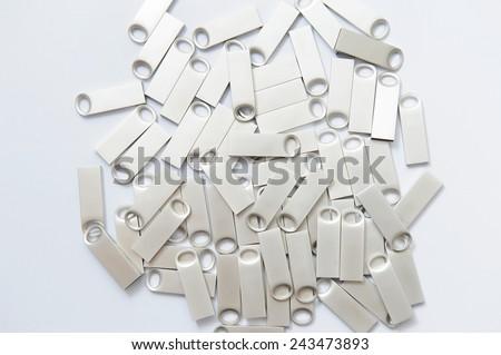 memory sticks made of metal on white - stock photo