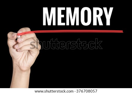 Memory word writing by men hand holding red highlighter pen on dark background - stock photo