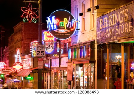 MEMPHIS, USA - NOVEMBER 25: Neon signs of famous blues clubs on historical Beale street on November 25, 2008. Beale street is a major tourist attraction and a place for blues festivals and concerts - stock photo
