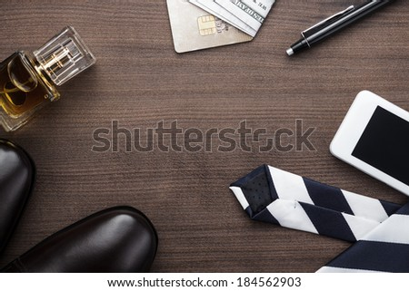 men accessories on the brown wooden table - stock photo