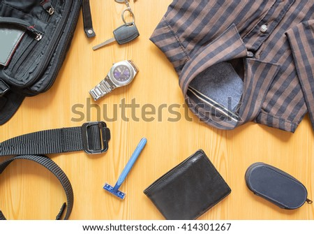Men accessories: shirt, razor, pen,wallet,watch,Belt,bag and keys on the  wood background.  - stock photo