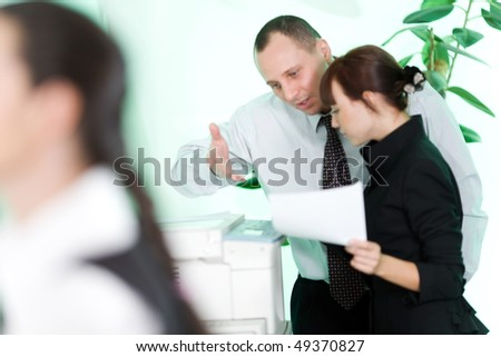 Men and nice girl with paper - stock photo