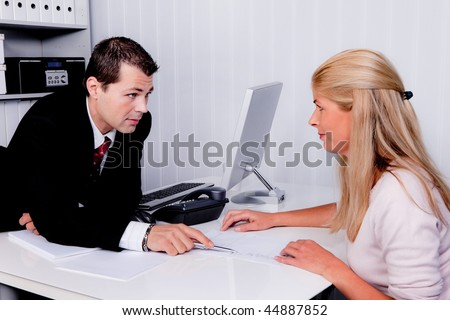Men and women during a consultation - stock photo