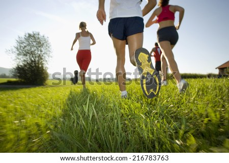 Men and women jogging. - stock photo