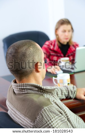 men and women talking over a cup of coffee - stock photo
