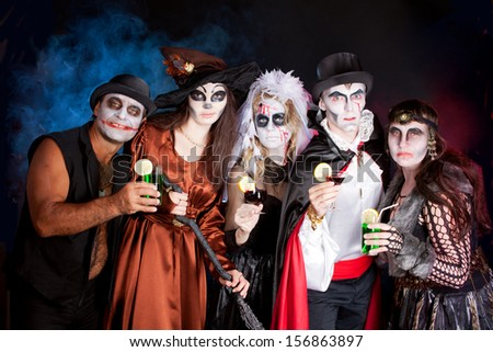 men and women  wearing  as  vampire, witch, dead bride for Halloween - stock photo