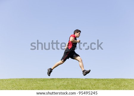 Men athlete running at the city park - stock photo