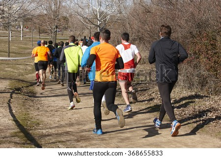 Men athletics runners on a race. Outdoor circuit. Horizontal - stock photo