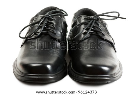 Men black shoes with black laces over white background - stock photo