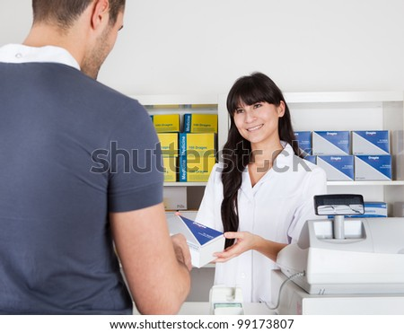 Men buying some medicine at the drugstore - stock photo