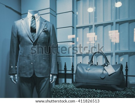 Men clothing in a luxury store(window display view) - stock photo