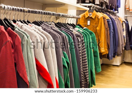Men Clothing in Fashion Store - Fleece Shirts on the Store Rack - stock photo