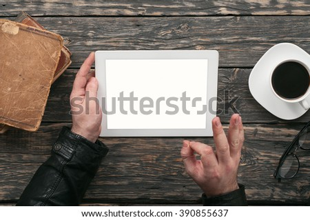 Men communicate using tablet computer through the Internet in cafe - stock photo
